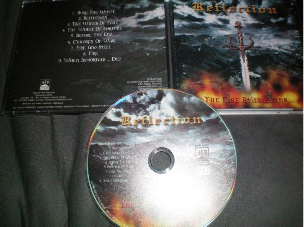 REFLECTION: The Fire Still Burns CD Mint condition. Truest Epic Doom Heavy Metal. Check samples. HIGHLY RECOMMENDED
