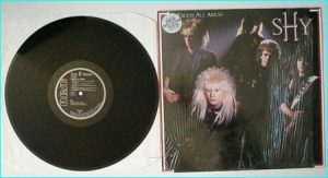 "SHY: Excess All Areas [1987 LP. Contains ""Emergency"" and a Dokken written hit] Check audio"