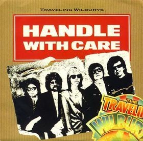 "TRAVELING WILBURYS: Handle With Care 7"". George Harrison, Roy Orbison, Tom Petty, Bob Dylan. Check video"