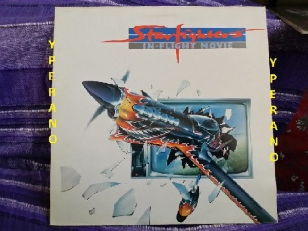 STARFIGHTERS: In Flight movie LP. Mint vinyl. Hard Rock AC/DC type w. members of the Young family. Check audio
