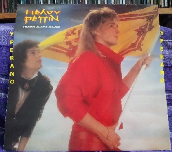 HEAVY PETTIN: Rock Ain't Dead LP + inner. 1985 NWOBHM masterpiece. Vinyl in VG+ condition, original UK.